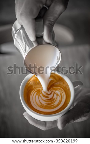 Cup of coffee latte in coffee shop - stock photo