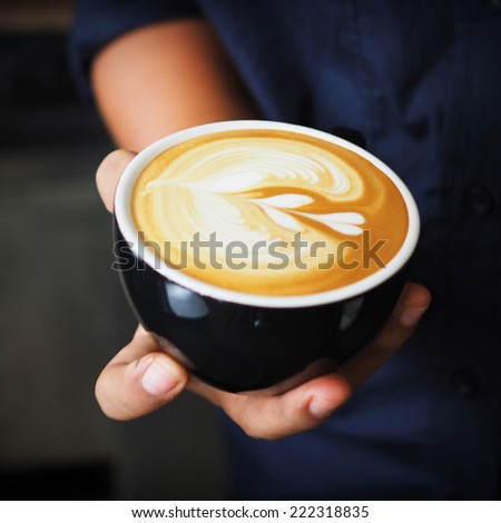 cup of coffee latte in coffee shop vintage color - stock photo