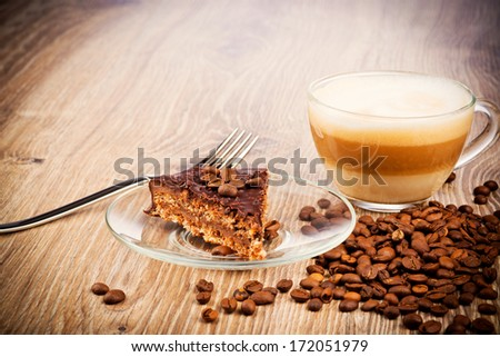 Cup of coffee latte with chocolate cake - stock photo