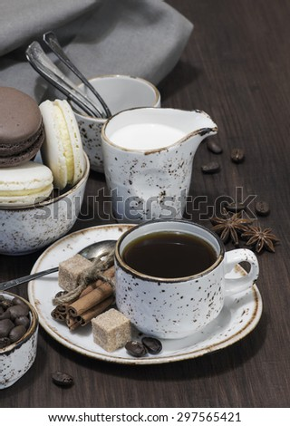 Cup of coffee, macaroons and linen napkin - stock photo