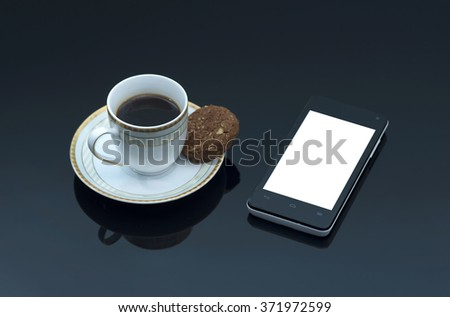 Cup of coffee, mobile phone and cookies on black background
