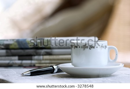 cup of coffee, morning newspapers, pen - stock photo