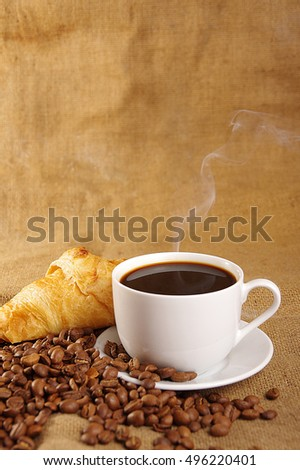 cup of coffee on a background sacking