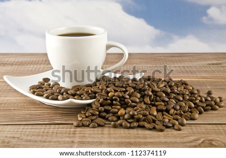 cup of coffee on a background sky - stock photo