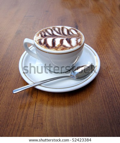 Cup of coffee on a brown wooden table - stock photo