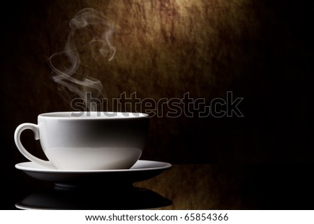 cup of coffee  on a old stone background. - stock photo