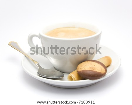 Cup of Coffee on a saucer with some cookies and a silver spoon - stock photo