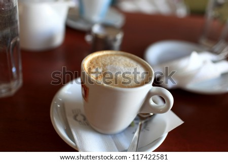 Cup of coffee on a table in the restaurant - stock photo