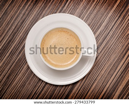 Cup of Coffee on a wood table, top view - stock photo