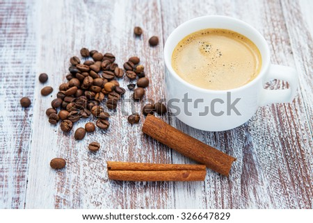 Cup of coffee on a wooden table. - stock photo