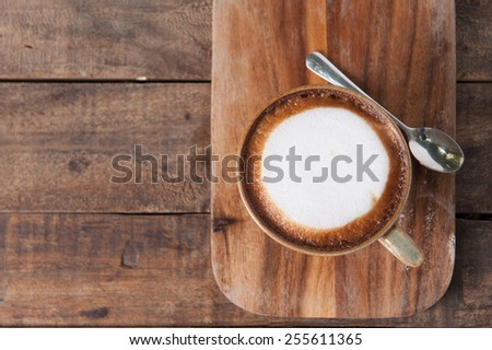 Cup of coffee on a wooden table background - stock photo