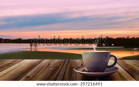 cup of coffee on abstract nature background - stock photo