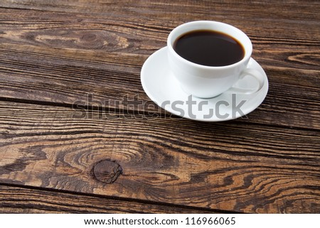 Cup of coffee on an old wooden table - stock photo