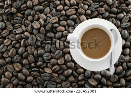 Cup of coffee on beans  background - stock photo