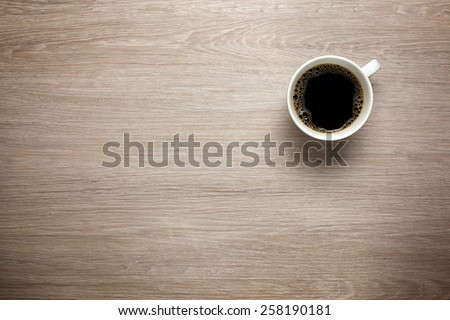 Cup of coffee on desk - stock photo