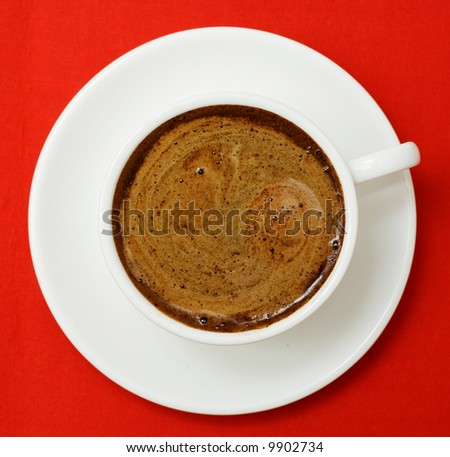 Cup of coffee on red. - stock photo