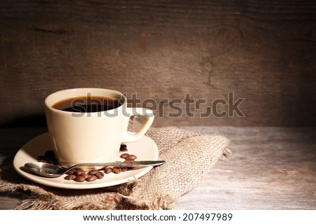 Cup of coffee on rustic wooden background - stock photo