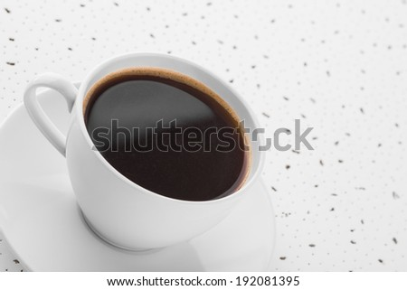 Cup of coffee on spotty white background
