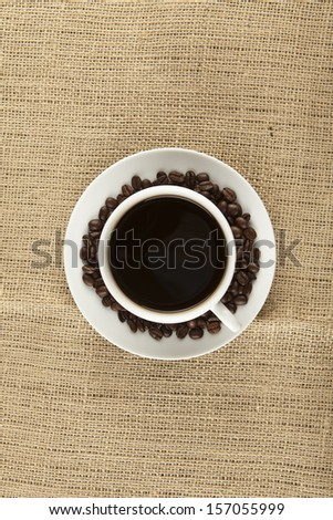 Cup of Coffee on Table. - stock photo