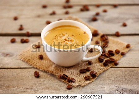 Cup of coffee on table close-up - stock photo