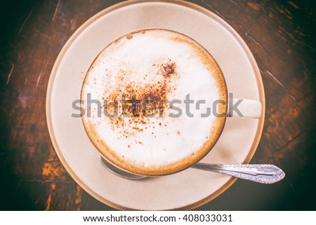 Cup of coffee on table close up, top view. - stock photo