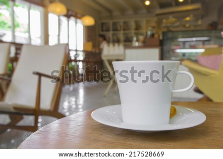 cup of coffee on table in cafe - stock photo