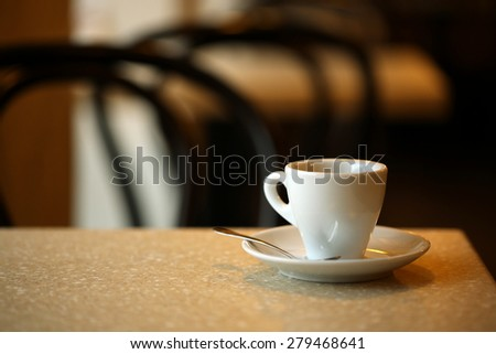 Cup of coffee on table in cafe