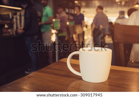 Cup of coffee on table in cafe , Coffee Shop Blurred background - stock photo