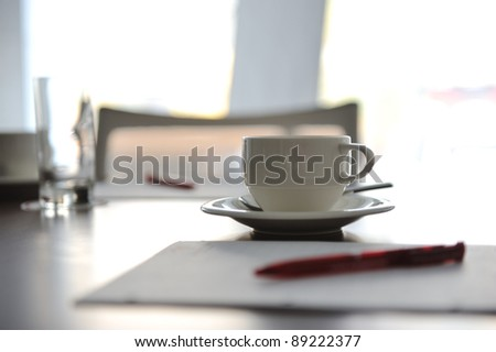 Cup of coffee on table in the conference room - stock photo
