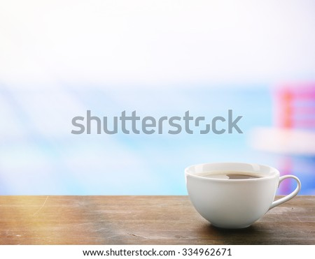 Cup of coffee on table on light background - stock photo