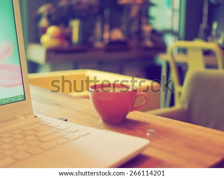 cup of coffee on the desk with laptop vintage color tone