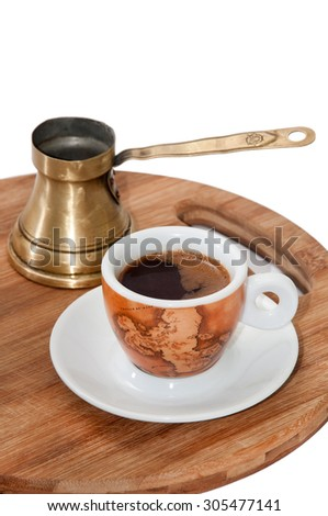 Cup of coffee on the wooden board.