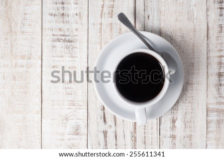 Cup of coffee on white  wooden table background - stock photo