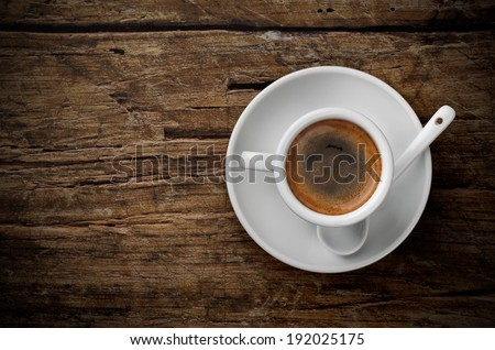 Cup of coffee on wood board - stock photo