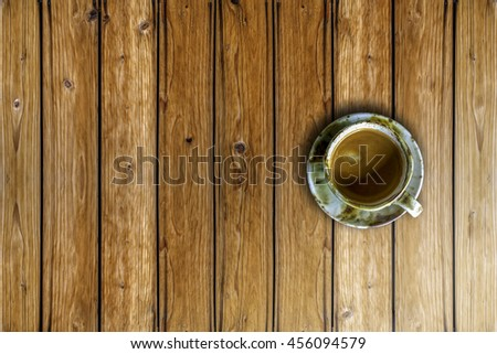 cup of coffee on wood table. - stock photo