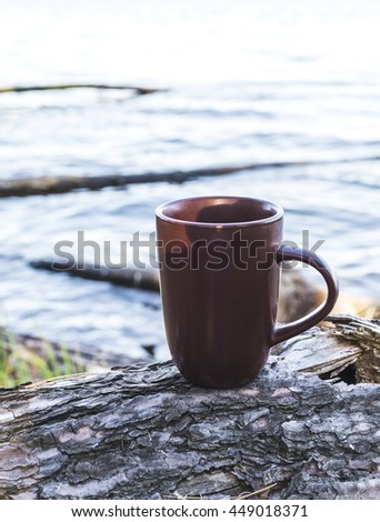cup of coffee on wood with nature on background. Tourism and travel - stock photo