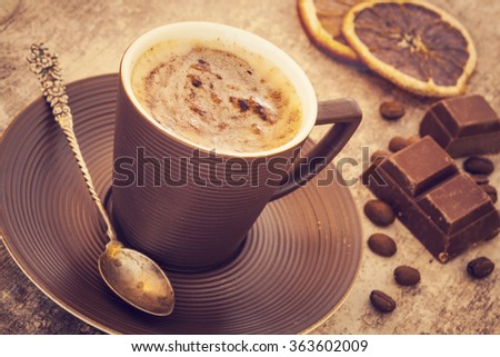 Cup of coffee on wooden