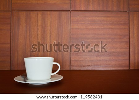 cup of coffee on wooden background - stock photo