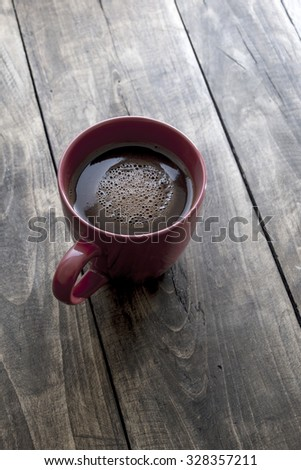 Cup of coffee on wooden background, close up - stock photo