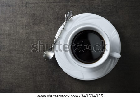 Cup of coffee on wooden  dark table, from above