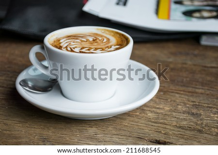 Cup of Coffee on Wooden Table. - stock photo