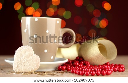 cup of coffee on wooden table on bright bokeh backdground - stock photo