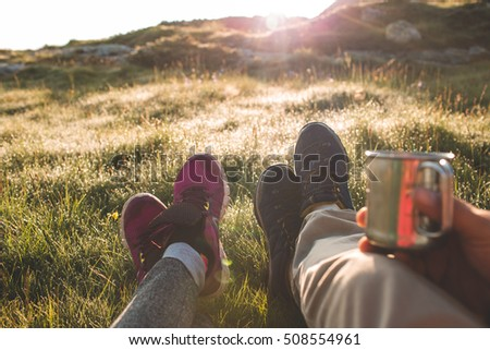 cup of coffee or tea in the hands. couple in the mountains drinking hot coffee or tea