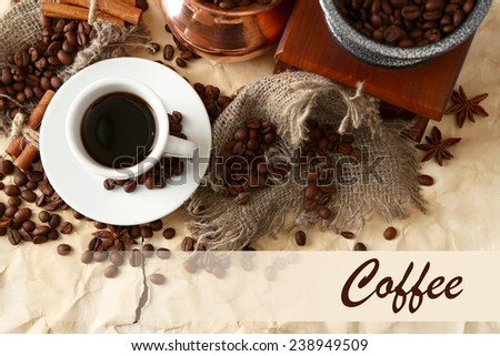 Cup of coffee, pot and grinder on beige background - stock photo