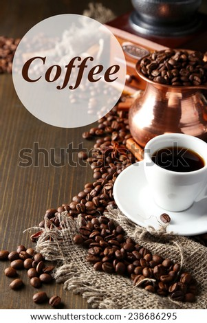 Cup of coffee, pot and grinder on wooden background - stock photo