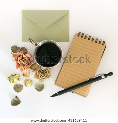 Cup of coffee, sketchbook, pencil and dried flowers. Flat lay - stock photo