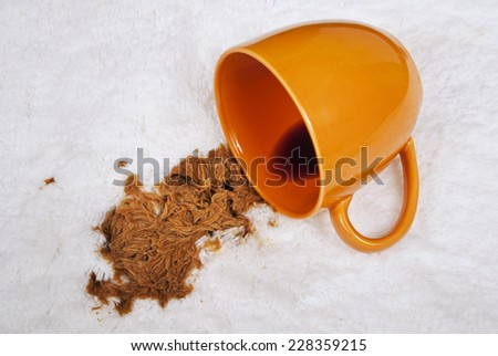 Cup Of Coffee Spilled On Carpet/ Spilled Coffee On White