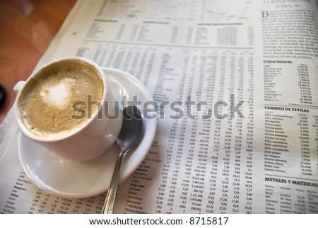 Cup of coffee, spoon and newspapers - stock photo