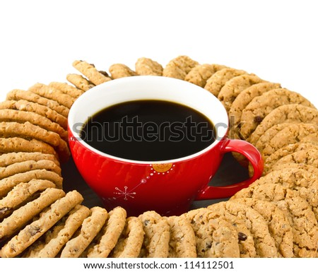 Cup of coffee surrounded by cookies on white