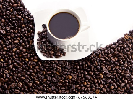 cup of coffee surrounded coffee beans on white background
